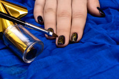 Painting fingers with dark blue nails Royalty Free Stock Photos