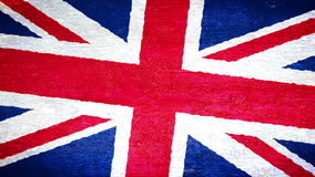 Painting flag on the wall - UK. Roller painting United Kingdom flag on concrete wall stock footage