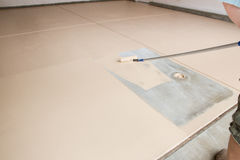 Painting Floor of Garage stock photos