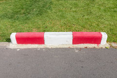 Painting on footpath and the street with red and white color in. Public park Stock Images