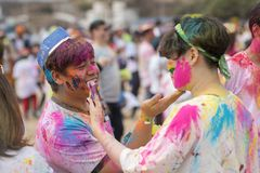 Geoje, SOUTH KOREA - MARCH 2018: Holi festival. Painting on the friend`s face Stock Photo