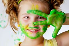 Painting is fun for kid. Happy child plays in the paint at home during the renovation Royalty Free Stock Photography