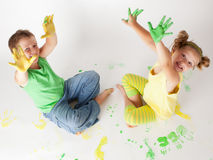 Painting is fun for kids. Happy children play with the paint Royalty Free Stock Image
