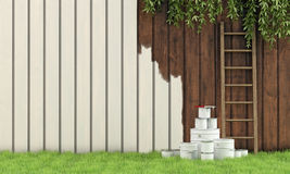 Painting the garden fence Stock Images