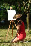 Painting girl. In the nature Stock Image