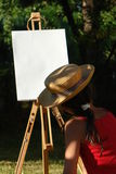 Painting girl. In the nature Stock Photos