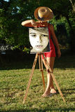 Painting girl. In the nature Royalty Free Stock Images
