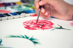 Painting gorgeous red rose on paper by paintbrush.  Stock Image