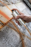 Painting graffiti on the wall Stock Photography