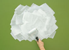 Painting green wall in white with paint roller Royalty Free Stock Photography