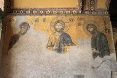 Painting in Hagia Sofia in Istanbul. Decorated wall with christian painting of Jesus and two other saints on wall in former church and mosque and current museum Royalty Free Stock Photos
