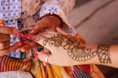 Painting hand with henna in flower design Royalty Free Stock Image