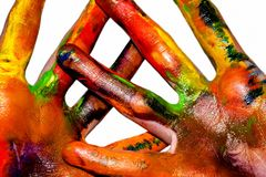 Painting hands. Photo of hands painted in different colors stock photo