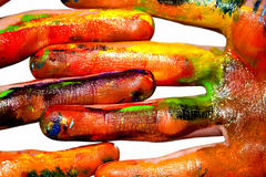 Painting hands. Photo of hands painted in different colors royalty free stock photo
