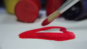 Painting A Heart. Macro footage of painting a heart. Perfect for valentines day