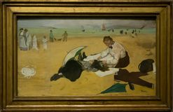 A painting by Hilaire German Edgar Degas in the National Gallery in London. A painting by Hilaire German Edgar Degas - Beach Scene. Beautiful framed painting in stock image