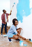 Painting house couple Stock Image