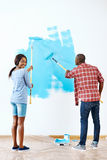Painting house couple Royalty Free Stock Photos