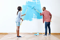 Painting house couple Royalty Free Stock Image