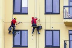 Painting house facade. Painting house facade by using a ropes Stock Photo
