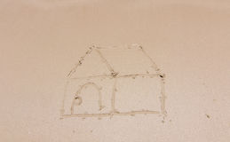 Painting a house on sand Stock Photo