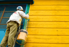 Painting houses in La boca. Buenos Aires district Royalty Free Stock Image