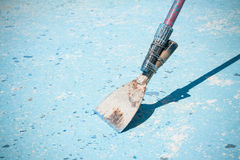 Painting a huge blue Swimming Pool. A maintenance worker pool Stock Photo
