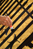 Painting an iron gate Royalty Free Stock Image