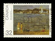 Painting by Jean Paul Lemieux. CANADA - CIRCA 1984: A stamp printed in Canada shows painting by Jean Paul Lemieux, `New Brunswick`, Canada Day series, circa 1984 stock image