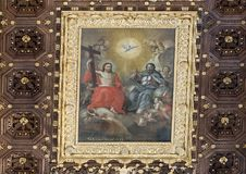 Painting of Jesus on the rich wooden caisson ceiling, Basilica di Santa Croce stock images