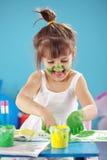Painting kid girl Stock Photos