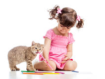 Painting kid girl with playful kitten Royalty Free Stock Photo