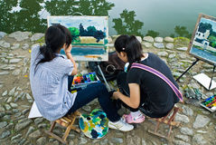 Painting beside the lake Royalty Free Stock Photography