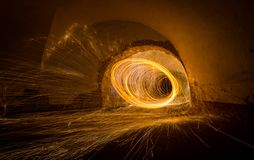 Painting with light - fire spinning in closed space stock photography
