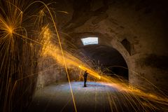 Painting with light - fire spinning in closed space royalty free stock image