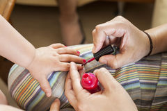 Painting little girls nails stock photo