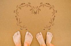 Painting love heart on beach Stock Photography