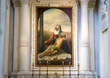 Painting of Madonna mourning crucified Jesus above one of the altars, Basilica di Santa Croce. Pictured is a painting of Madonna mourning the crucified Jesus Royalty Free Stock Photo