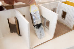 Painting the marquetry model house Stock Image