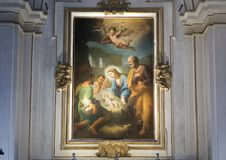 Painting of Mary and the Baby Jesus above an altar inside the Basilica Saint Maria in Trastevere. Pictured is a painting of baby inside the Basilica Saint Maria royalty free stock images