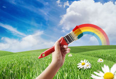 Painting a Meadow and Rainbow Royalty Free Stock Photos