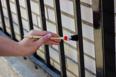 Painting metal fence Stock Image