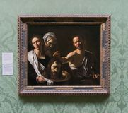 A painting by Michelangelo Merisi da Caravaggio in the National Gallery in London. A painting by Michelangelo Merisi da Caravaggio - Salome receives the Head of Royalty Free Stock Images