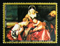 Painting `Mystical marriage of Ste Catherine` by Lotto, Paintings from the Old Pinakothek, Munich serie, circa 1972. MOSCOW, RUSSIA - OCTOBER 1, 2017: A stamp Stock Photos
