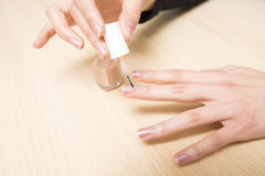 Painting nail polish Stock Image