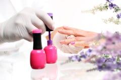 Painting nail varnish color Royalty Free Stock Photos