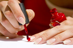 Painting nails red Stock Images