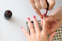 Painting nails red Stock Image