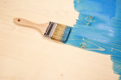 Painting natural wood in blue Royalty Free Stock Photo