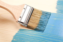 Painting natural wood in blue Royalty Free Stock Image